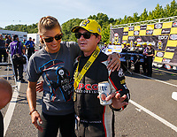 Jun 11, 2017; Englishtown , NJ, USA; NHRA top fuel driver Steve Torrence (right) celebrates with Leah Pritchett after winning the Summernationals at Old Bridge Township Raceway Park. Mandatory Credit: Mark J. Rebilas-USA TODAY Sports