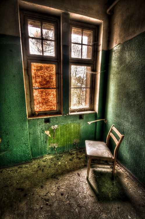 Abandoned lunatic asylum north of Berlin, Germany. Chair in empty room.