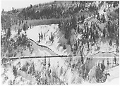 View of RGS K-27 #455 working down grade on Keystone Hill having just crossed Bridge 42A with an ore train while pushing flanger 02.<br /> RGS  Keystone Hill, CO  Taken by Chione, A. G. - 1951