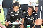 Palos Verdes, CA 02/03/12 - Charles Chae (Peninsula #9) and Tony Bumatay (Peninsula #5) in action during the Peninsula vs Palos Verdes boys varsity soccer game.