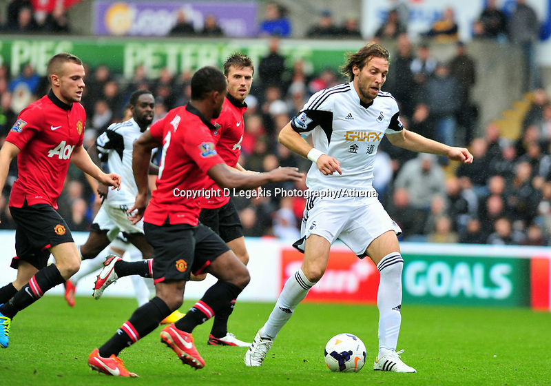 Michu on the ball.<br /> Saturday 17 August 2013<br /> Pictured: <br /> Re: Barclays Premier League Swansea City v Manchester United at the Liberty Stadium, Swansea, Wales