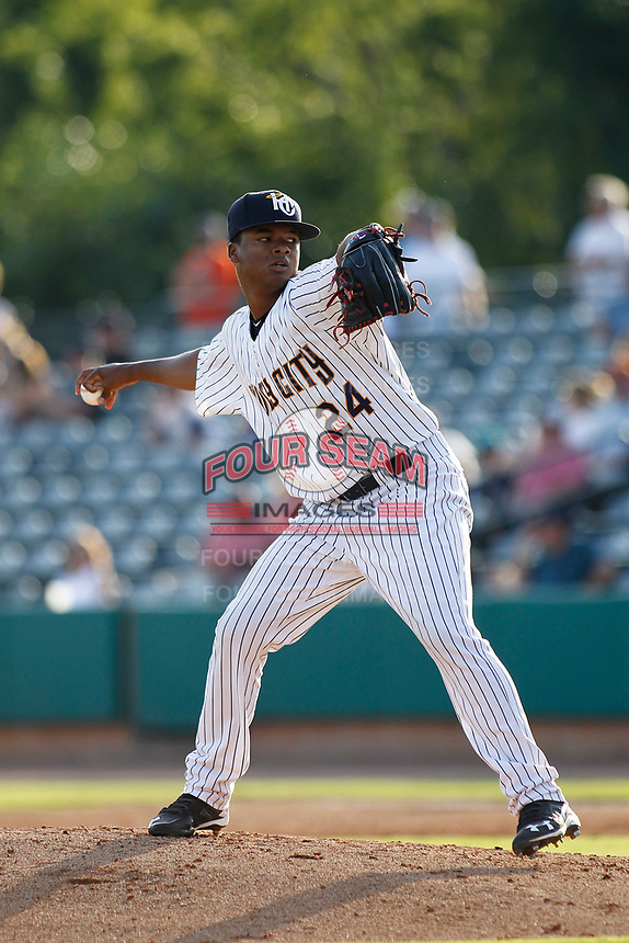 """Charleston Riverdogs pitcher Daniel Ramos (24) on the mound during a game against the Hickory Crawdads at the Joseph P. Riley Ballpark in Charleston, South Carolina. For Sunday games, the Riverdogs wear their """"Holy City"""" uniforms in honor of the city's nickname. Hickory defeated Charleston 8-7. (Robert Gurganus/Four Seam Images)"""