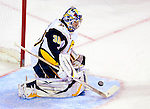 14 December 2009: Buffalo Sabres' goaltender Ryan Miller makes a third period save against the Montreal Canadiens at the Bell Centre in Montreal, Quebec, Canada. The Sabres defeated the Canadiens 4-3. Mandatory Credit: Ed Wolfstein Photo