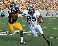 September 4, 2010: Coastal Carolina wide receiver Jonathan Morgan stiff arms a WVU defender. The West Virginia Mountaineers defeated the Coastal Carolina Chanticleers 31-0 on September 4, 2010 at Mountaineer Field, Morgantown, West Virginia.
