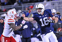 23 November 2013:  Penn State TE  Jesse James (18) stiff-arms Nebraska S Corey Cooper (6) during his long touchdown catch and run. The Nebraska Cornhuskers defeated the Penn State Nittany Lions 23-20 in overtime at Beaver Stadium in State College, PA.