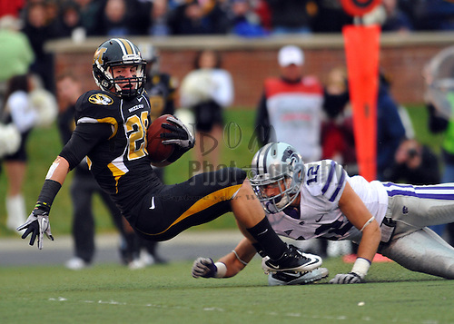 Nov 13, 2010; Columbia, MO, USA; Missouri Tigers wide receiver T.J. Moe (28) goes in for a touchdown in the first half as Kansas State Wildcats cornerback Ty Zimmerman (12) attempts the tackle at Memorial Stadium. Mandatory Credit: Denny Medley-US PRESSWIRE