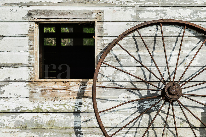Barn window and wheel detail.