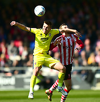 Cheltenham Town's Kevin Dawson battles with Lincoln City's Harry Toffolo<br /> <br /> Photographer Andrew Vaughan/CameraSport<br /> <br /> The EFL Sky Bet League Two - Lincoln City v Cheltenham Town - Saturday 13th April 2019 - Sincil Bank - Lincoln<br /> <br /> World Copyright &copy; 2019 CameraSport. All rights reserved. 43 Linden Ave. Countesthorpe. Leicester. England. LE8 5PG - Tel: +44 (0) 116 277 4147 - admin@camerasport.com - www.camerasport.com