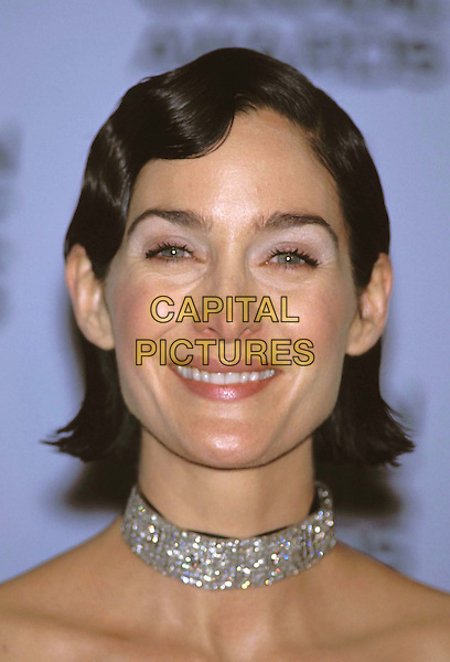 CARRIE ANNE MOSS..Golden Globe Awards..diamond choker, headshot, portrait..www.capitalpictures.com..sales@capitalpictures.com..©Capital Pictures