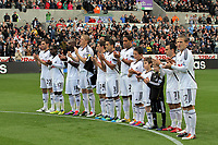 Pictured: Swansea players applaud in tribute to the four dead Glieison Colliery miners, they also observed a minute's silence. Saturday 17 September 2011<br />