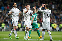 Real Madrid´s James Rodriguez celebrates a goal with Chicharito and Arbeloa during Spanish King Cup match between Real Madrid and Cornella at Santiago Bernabeu stadium in Madrid, Spain.December 2, 2014. (NortePhoto/ALTERPHOTOS/Victor Blanco)