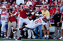 04 Sep 2010: Nebraska Cornhuskers defensive end Pierre Allen makes a big hit on Western Kentucky Hilltoppers quarterback Kawaun Jakes (6) at Memorial Staduim in Lincoln, Nebraska. Nebraska defeated Western Kentucky 49 to 10.