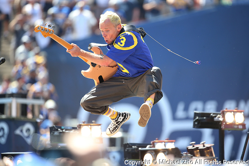 09/18/16 Los Angeles, CA: Flea and the Red Hot Chili Peppers perform before the Los Angeles Rams 2016 Home Opener at the Los Angeles Coliseum.