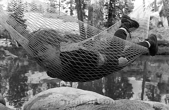 Andrew Wilcox in hammock at Sword Lake<br />