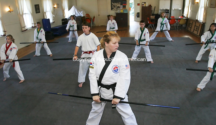 OXFORD,  CT 28 September 2005 -092805BZ02- Instructor Amy Cote, center, instructs a martial arts class run by the Oxford Parks and Recreation Department.  <br /> Students are taught Cheezic Tang Soo Do, an empty-hand, power-base style from Korea. Instructor Amy Cote said more than 150 children and adults take part in the classes.<br /> Jamison C. Bazinet / Republican-American