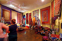 People browse at a show of Turkish carpets at Roy Ventner Gallery in Chinatown, downtown Honolulu.