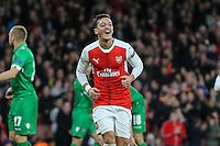 Mesut Ozil of Arsenal celebrates scoring his third goal against Ludogorets Razgrad to make it 6-0 during the UEFA Champions League match between Arsenal and PFC Ludogorets Razgrad at the Emirates Stadium, London, England on 19 October 2016. Photo by David Horn / PRiME Media Images.