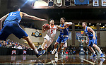 SIOUX FALLS, SD - MARCH 8:  Shane Maple #5 from Governors State drives against Tyson Smiley #11 from Dakota Wesleyan at the 2018 NAIA DII Men's Basketball Championship at the Sanford Pentagon in Sioux Falls. (Photo by Dave Eggen/Inertia)