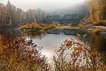 Idaho, North, Benewah County, St. Maries. An old railroad bridge, on the Milwaukee-St. Paul Linecrosses the St. Joe river on a foggy autumn morning.