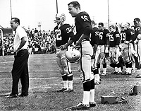 Al Davis coaching the Oakland Raiders at Frank Youell Field in downtown Oakland,behind his is #15 Tom Flores. (photo copyright 1963 Ron Riesterer)