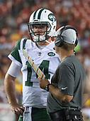 New York Jets quarterback Sam Darnold (14) discusses strategy on the sideline during a break in the second quarter of the game against the Washington Redskins at FedEx Field in Landover, Maryland on Thursday, August 16, 2018.<br /> Credit: Ron Sachs / CNP<br /> (RESTRICTION: NO New York or New Jersey Newspapers or newspapers within a 75 mile radius of New York City)