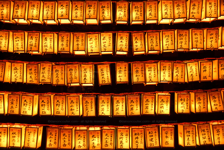 A display of yellow paper lanterns, each carrying the name of a fallen serviceman, at the Mitama matsuri or festival of remembrance for Japanese war dead Yasukuni shrine, Tokyo, Japan, Monday, July 16th 2007