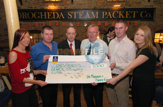 Joanne Neary, Brian Moore, Paddy Kierans CF, Peter Hughes C.F. Thomas Murphy and Aileen Sweeney with a cheque for Û7000 raised in the Mariner by a sponsored head shave...Photo Fran Caffrey Newsfile.ie..This Picture has been sent to you by Newsfile Ltd..The Studio,.Millmount Abbey,.Drogheda,.Co. Meath,.Ireland..Tel: +353(0)41-9871240.Fax: +353(0)41-9871260.ISDN: +353(0)41-9871010.www.newsfile.ie..general email: pictures@newsfile.ie