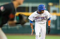 Florida Gators outfielder Buddy Reed (23) hustles towards third base against the Miami Hurricanes in the NCAA College World Series on June 13, 2015 at TD Ameritrade Park in Omaha, Nebraska. Florida defeated Miami 15-3. (Andrew Woolley/Four Seam Images)