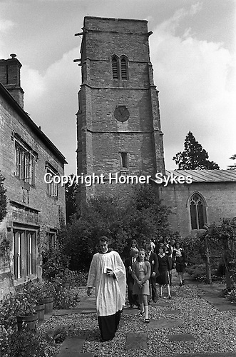 The Wicken Love Feast, takes place on Ascension Day and celebrates the joining together of two parishes in 1587. Wicken Northamptonshire 1970s Uk.  The congregation walk from the church to the Gospel Oak for a short open air service. <br /> <br /> My ref 17a/1370/ 1976?