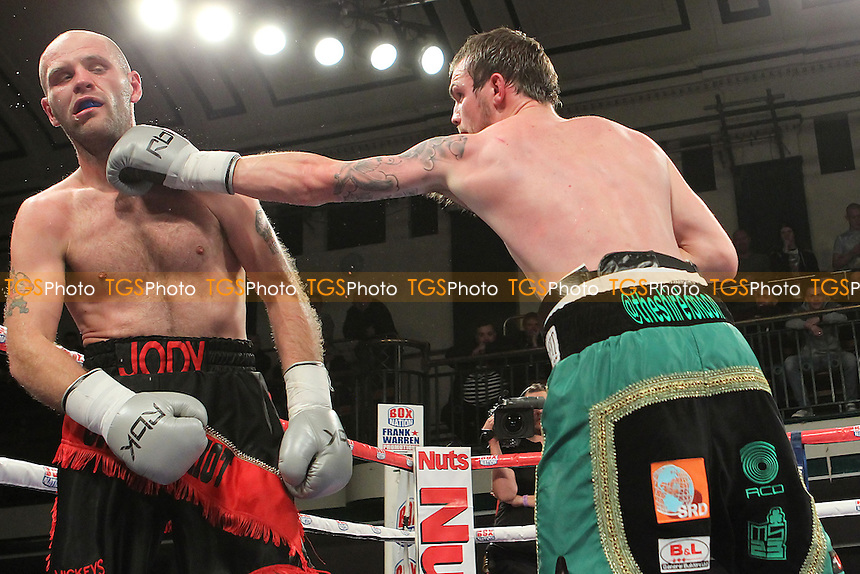 Miles Shinkwin (black/green shorts) defeats Jody Meikle in a Light-Heavyweight boxing contest at York Hall, Bethnal Green, London, promoted by Frank Warren - 01/11/12 - MANDATORY CREDIT: Gavin Ellis/TGSPHOTO - Self billing applies where appropriate - 0845 094 6026 - contact@tgsphoto.co.uk - NO UNPAID USE.