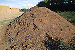 Large pile of organic compost material to be used in farming, Alderton, Suffolk, England