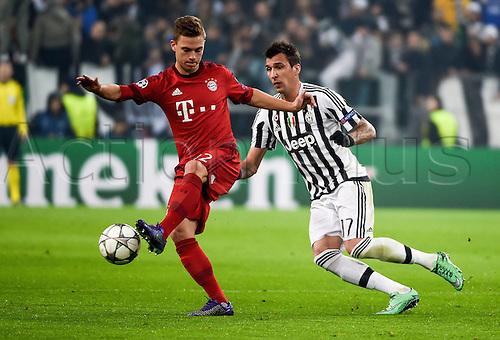 23.02.2016. Turin, Italy. UEFA Champions League football. Juventus versus Bayern Munich.  Joshua Kimmich (FC Bayern Mun), Mario Mandzukic (Juventus)
