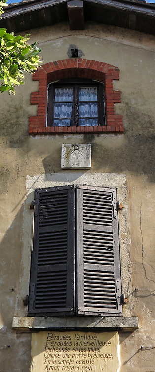 """VMI Vincentian Heritage Tour: An old sundial mounted outside a window on a home in the small village of Pérouges  - Tuesday, June 28, 2016, site of the classic film """"Monsieur Vincent"""". (DePaul University/Jamie Moncrief)"""