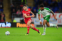 Ben Davies of Wales vies for possession with Cyrus Christie of Republic of Ireland during the UEFA Nations League B match between Wales and Ireland at Cardiff City Stadium in Cardiff, Wales, UK.September 6, 2018
