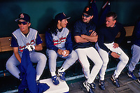 SAN FRANCISCO, CA - Bill Swift and Mark Carreon of the San Francisco Giants sit in the dugout and talk to members of the Colorado Silver Bullets women's baseball team before a game at Candlestick Park in San Francisco, California in 1995. (Photo by Brad Mangin)