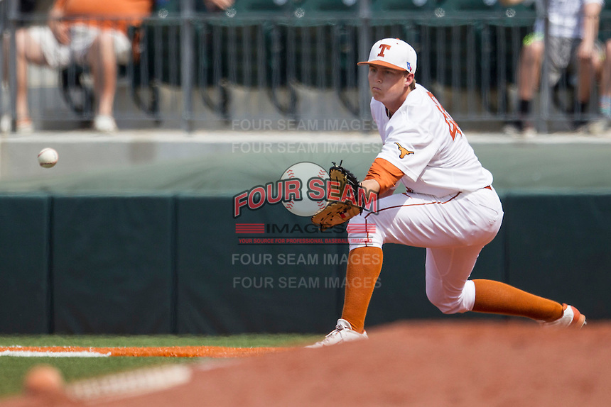Texas Longhorns first baseman Kacy Clemens #42 makes a putout during the NCAA baseball game against the Oklahoma State Cowboys on April 26, 2014 at UFCU Disch–Falk Field in Austin, Texas. The Cowboys defeated the Longhorns 2-1. (Andrew Woolley/Four Seam Images)