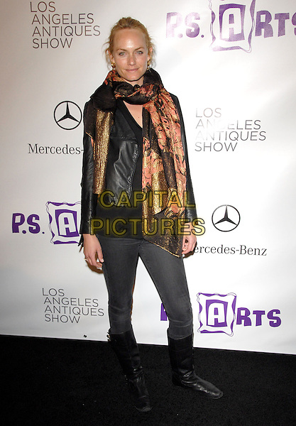 AMBER VALLETTA .at the 15th Annual L.A. Antiques Show 2010 held at Barkar Hangar in Santa Monica, California, USA, .April 21st, 2010..full length brown orange gold black print scarf leather jacket jeans knee high boots tucked in jeggings .CAP/RKE/DVS.©DVS/RockinExposures/Capital Pictures