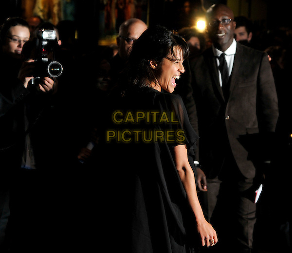 """MICHELLE RODRIGUEZ  .Arrivals - World Premiere of """"Avatar"""",  Odeon Leicester Square, London, England, UK, December 10th, 2009..half length black dress mouth open side profile funny photographer camera .CAP/PL.©Phil Loftus/Capital Pictures."""