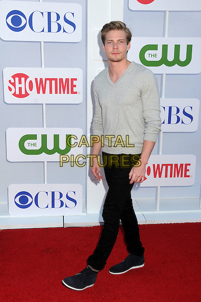 Hunter Parrish.CBS, CW, Showtime 2012 Summer TCA Party held at The Beverly Hilton Hotel, Beverly Hills, California, USA..July 29th, 2012.full length black jeans denim grey gray stubble facial hair .CAP/ADM/BP.©Byron Purvis/AdMedia/Capital Pictures.