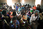 MPHANDULA, MALAWI - AUGUST 20: Unidentified villagers pray during a church service at the African Abraham Church on August 20, 2006 in Mphandula village, about 30 miles outside Lilongwe, Malawi. Mphandula is a poor village in Malawi, without electricity or clean water. Nobody owns a car or a mobile phone. Most people live on farming. About 7000 people reside in the village and the chief estimates that there are about five-hundred orphans. Many have been affected by HIV/Aids and many of the children are orphaned. A foundation started by Madonna has decided to build an orphan center in the village through Consol Homes, a Malawi based organization. Raising Malawi is investing about 3 million dollars in the project and Madonna is scheduled to visit the village in October 2006. Malawi is a small landlocked country in Southern Africa without any natural resources. Many people are affected by the Aids epidemic. Malawi is one of the poorest countries in the world and has about 1 million orphaned children. (Photo by Per-Anders Pettersson)