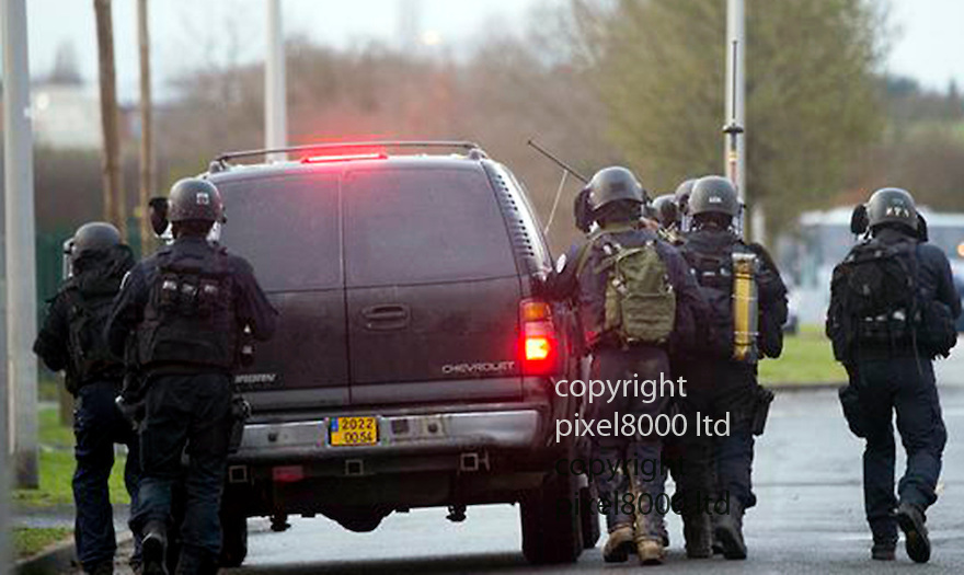 Pic shows:  Photos released of raid on printing works in Dammartin<br /> Police and snipers prepare to go in on raised platform<br /> <br /> <br /> <br /> Picture by French Police supplied Pixel8000 07917221968
