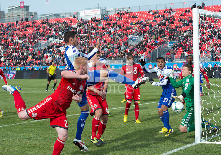 06 April 2013: Toronto FC goalkeeper Joe Bendik #12 makes a save during an MLS game between FC Dallas and Toronto FC at BMO Field in Toronto, Ontario Canada..The game ended in a 2-2 draw..