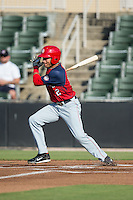 Bryan Mejia (12) of the Hagerstown Suns follows through on his swing against the Kannapolis Intimidators at Intimidators Stadium on July 18, 2015 in Kannapolis, North Carolina.  The Intimidators defeated the Suns 1-0.  (Brian Westerholt/Four Seam Images)
