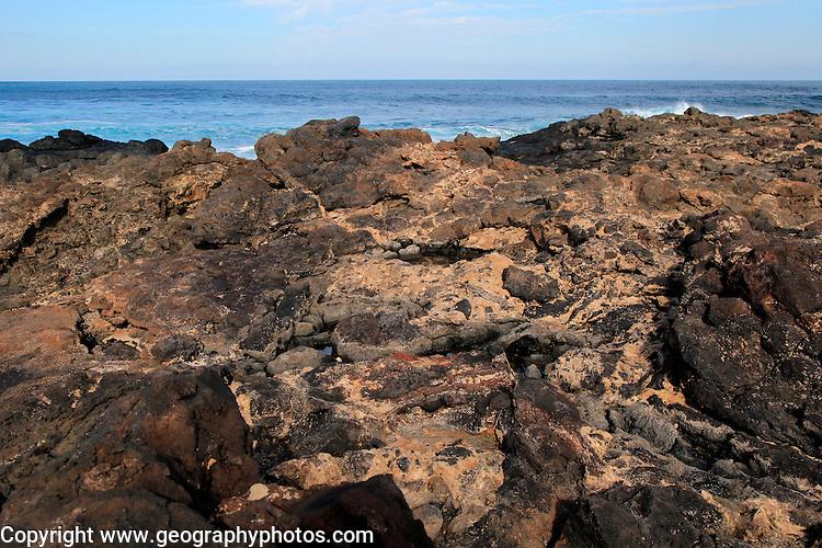 Lava flow volcanic rocks on beach near Majanicho on north coast of Fuerteventura, Canary Islands, Spain