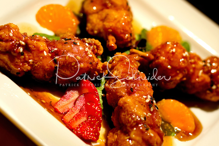 Photography of plated food at Union Street Bistro. Image shows Chicken Bacon Brochette with Sesame Oriental Sauce.  Union Street Bistro is located at 48 Union Street South in downtown Concord, North Carolina. Photo is part of a photographic series of images featuring Concord, NC, by photographer Patrick Schneider.