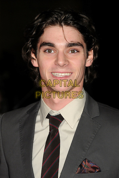 "RJ Mitte.""John Carter"" Los Angeles Premiere held at Regal Cinemas L.A. Live, Los Angeles, California, USA..February 22nd, 2012.headshot portrait grey gray beige shirt black .CAP/ADM/BP.©Byron Purvis/AdMedia/Capital Pictures."
