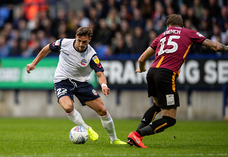 Bolton Wanderers' Dennis Politic goes around Bradford City's Tyler French (right) on his way to score his first goal<br /> <br /> Photographer Andrew Kearns/CameraSport<br /> <br /> EFL Leasing.com Trophy - Northern Section - Group F - Bolton Wanderers v Bradford City -  Tuesday 3rd September 2019 - University of Bolton Stadium - Bolton<br />  <br /> World Copyright © 2018 CameraSport. All rights reserved. 43 Linden Ave. Countesthorpe. Leicester. England. LE8 5PG - Tel: +44 (0) 116 277 4147 - admin@camerasport.com - www.camerasport.com