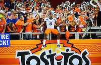 Jan. 4, 2010; Glendale, AZ, USA; Boise State Broncos safety (8) George Iloka celebrates with the fans following the game against the TCU Horned Frogs in the 2010 Fiesta Bowl at University of Phoenix Stadium. Boise State defeated TCU 17-10. Mandatory Credit: Mark J. Rebilas-