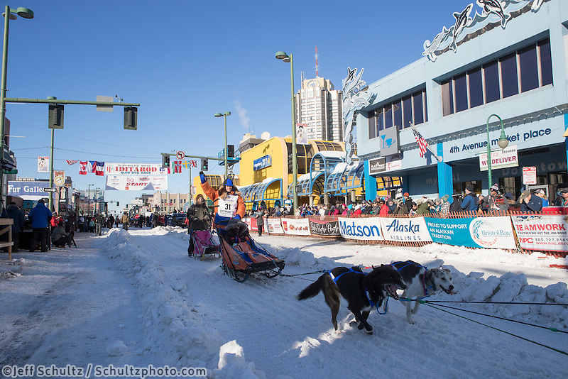Cindy Abbott and team leave the ceremonial start line with an Iditarider and handler at 4th Avenue and D street in downtown Anchorage, Alaska on Saturday March 4th during the 2017 Iditarod race. Photo © 2017 by Brendan Smith/SchultzPhoto.com.