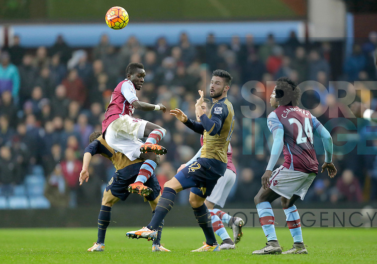 Idrissa Gueye of Aston Villa competes with Olivier Giroud of Arsenal  -  Football - Barclays Premier League - Aston Villa vs Arsenal - Villa Park Birmingham - 13th December 2015 - Season 2015/2016 - Photo Malcolm Couzens/Sportimage